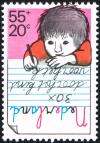 Colnect-2213-563-Boy-writing.jpg