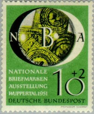 Colnect-152-113-Old-German-stamps-under-a-magnifying-glass.jpg
