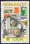 Colnect-2213-619-Stamps-and-magnifying-glass.jpg