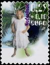 Colnect-667-611-Child-dressed-up-as-angel.jpg